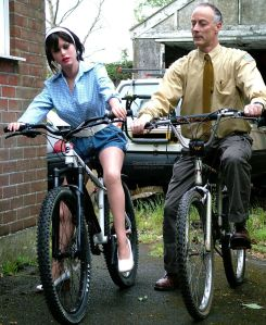 Joanna Realdoll and a man on mountain bikes in 2009