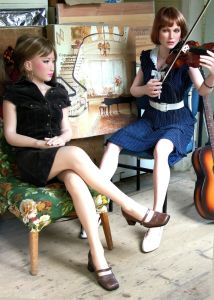 Life-size doll playing a violin
