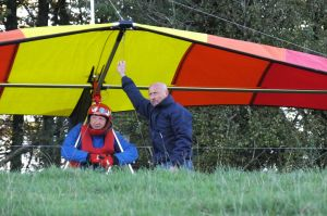 Hang glider pilots assessing conditions at Monk's Down