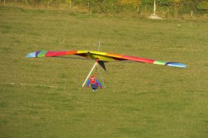 Hang glider flying towards the sun