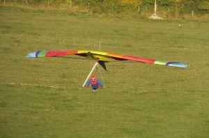 Hang glider flying towards the sun