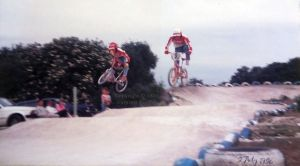 BMX bikes jumping at the Iford track, near Bournemouth, in July 1986