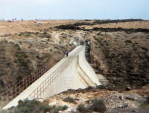 Carrying across the dam at Mala in Lanzarote, January or February 1989