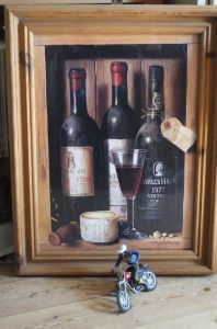 Scale model Vintage motocross bike with rider with print of wine bottles painting