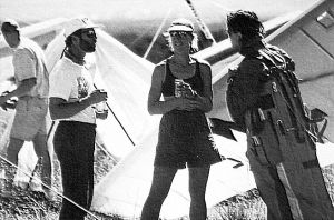 Art based on a photo by Jay Blackwood of Larry Tudor, Kari Castle, and Chris Arai after landing at Santa Fe in the 1994 Sandia Classic