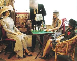 Three Realdolls being served tea by their owner