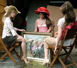 Three life-size dolls with a painting