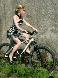 Annabelle Knighthorse life size doll riding a bicycle