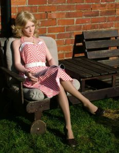 Annabelle Knighthorse life size doll sitting outdoors
