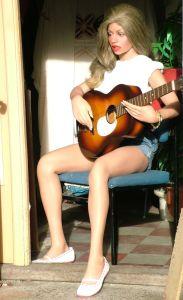 Varoline Realdoll playing guitar in 2009