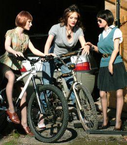 Life size dolls June, Anoushka, and Joanna Joanna on bicycles