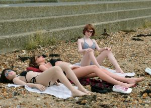 Laura, Anoushka, and June life-size dolls on a beach