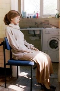 Rebecca Realdoll sitting in an English kitchen in 2003