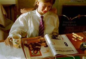 Rebecca Realdoll reading Marie Clare (French edition) in 2001