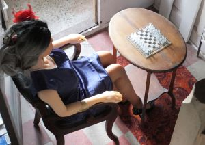 Life size doll playing chess