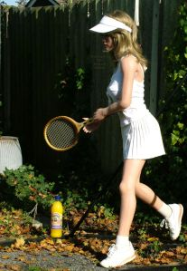 Life-size doll playing tennis