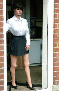 Life-size doll holding door open