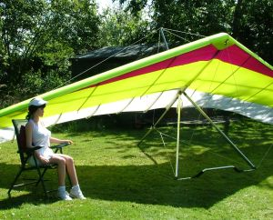 Realdoll sitting beside a hang glider
