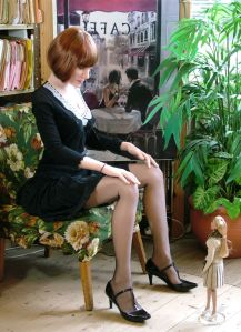 June life-size doll sitting in a chair