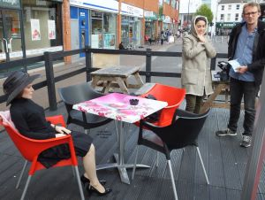 June life-size doll and film crew waiting for a taxi in Bournemouth