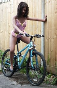 Kylie Realdoll posing on a bicycle