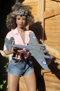Kylie Realdoll holding a 1/24th scale DeHaviland Mosquito
