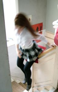 Laura 4woods jumping off a stair bannister