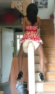 Lina Realdoll sliding down a stair bannister
