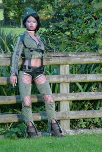 Lina Realdoll in flight gear leaning against a fence
