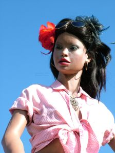 Lina Realdoll photographed against a blue sky