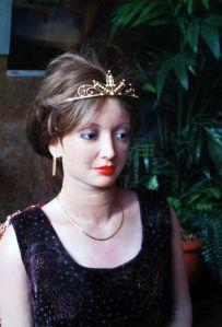 Rebecca Realdoll in a tiara and Caroline's dark purple dress
