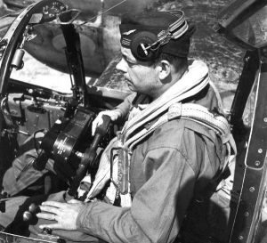Antoine de Saint-Exupéry sitting in the cockpit of a Lockheed F5A Lightning