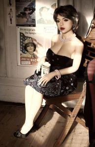 Sara YL doll sitting on a chair