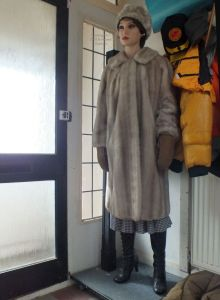 Virginia Realdoll in  fur coat and hat standing in a hall