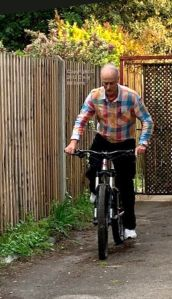 Everard testing a mountain bike in the yard in May 2019