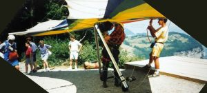 Everard clipping in to hang glider at St. Hilaire, 1994
