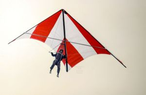 Everard flying a Skyhook IIIA standard Rogallo hang glider in early 1975