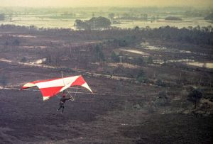 Everard encountering turbulence while flying a Skyhook 3A hang glider in 1975