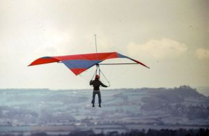 Roger P. flying a hang glider at Monks Down in 1975