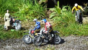 Revell 1/12th scale Husqvarna, Yamaha, and Suzuki 250 MX bikes with riders, and a pre-built Husky spare
