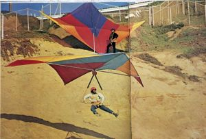 Photo by Leroy Grannis of a hang glider launching at Torrance Beach, likely in early 1974