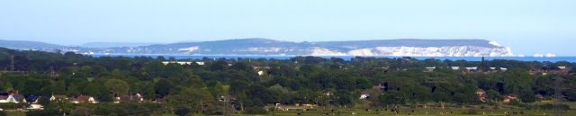 Isle of Wight viewed from St. Catherine's Hill, Christchurch, Dorset, England, in May 2020