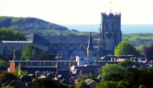 Priory and Hengistbury Head  viewed from St. Catherine's Hill, Christchurch, Dorset, England, in May 2020