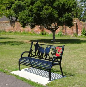 Great war seating in grounds near the priory, Christchurch, Dorset, England, in June 2020