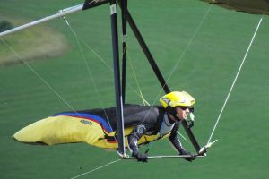 Close-up of pilot of hang glider flying at Mere, Wiltshire, UK, in June 2020