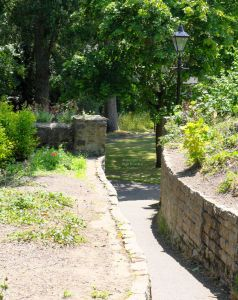 Walled path from the priory to Gorky Park, Christchurch, Dorset, England, in June 2020