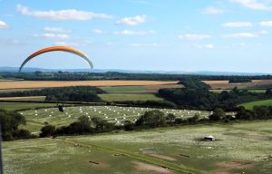 Paraglider in flight in north Dorset, England, July 2020