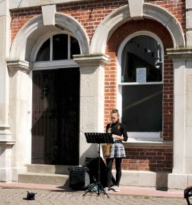 Saxophonist by the town hall, Christchurch, Dorset