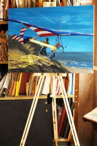 Final touch to painting by Everard Cunion of Mike Markowski launching the Eagle III hang glider