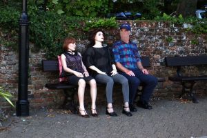 June and Faina life size dolls with their owner sitting on a bench in 2018